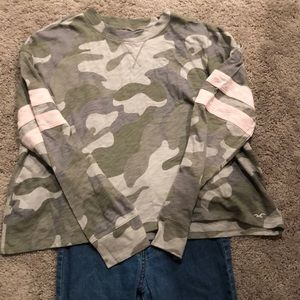 Gently used Camouflage shirt with blue jeans